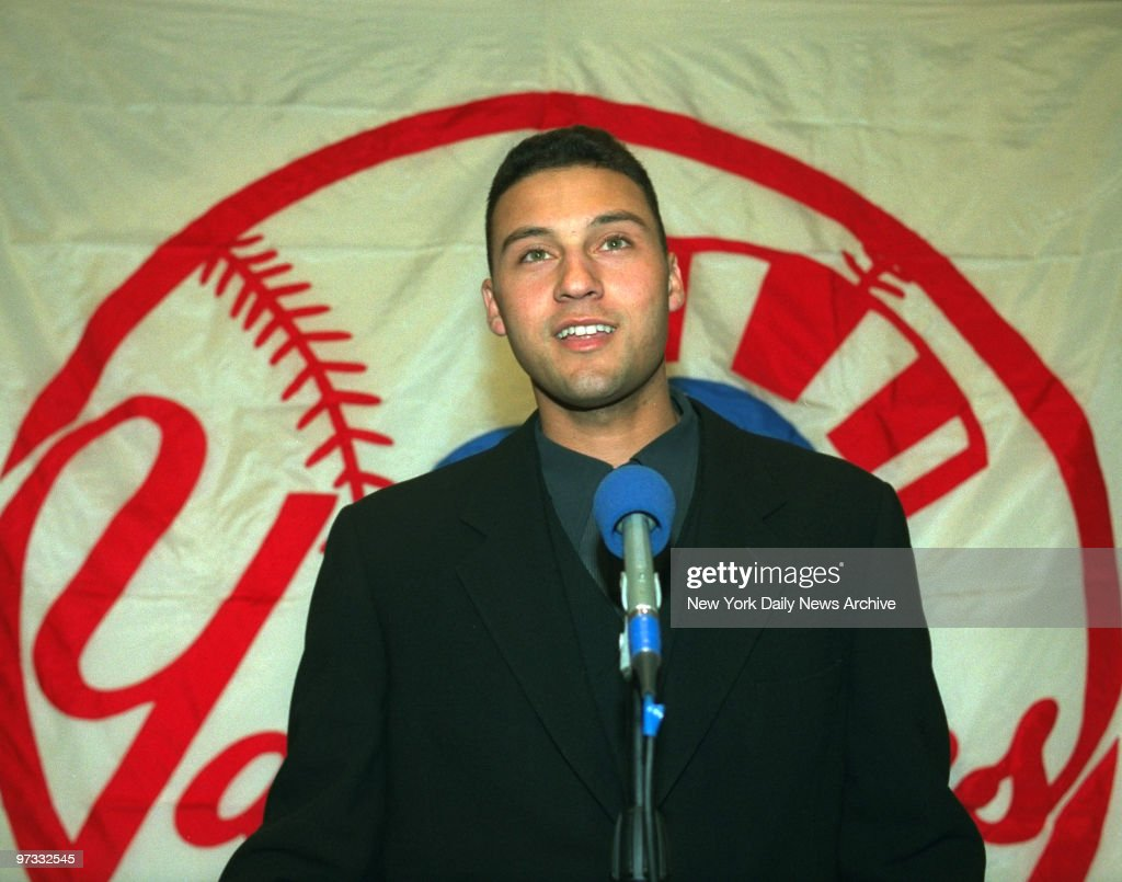Views of NY Yankees Derek Jeter as he was named Rookie of the Year by sports writers speakes ro press and get hugs from his father Dr Charles Jeter...