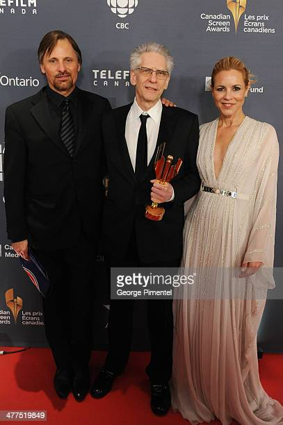 Viggo Mortensen David Cronenberg and Maria Bello pose in the press room at the 2014 Canadian Screen Awards at Sony Centre for the Performing Arts on...