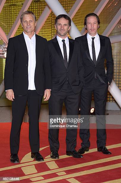 Viggo Mortensen director David Oelhoffen and Reda Kateb arrive on the red carpet for the evening tribute to Viggo Mortensen during the 14th Marrakech...