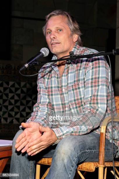 Viggo Motensen performs 'Dos Cuervos' a Poetic Lecture on May 12 2017 in Barcelona Spain