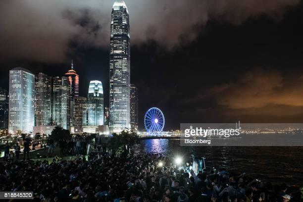 Vigil participants take part at a memorial vigil held for Chinese Nobel Peace Prizewinner Liu Xiaobo in Hong Kong China on Wednesday July 19 2017 Liu...
