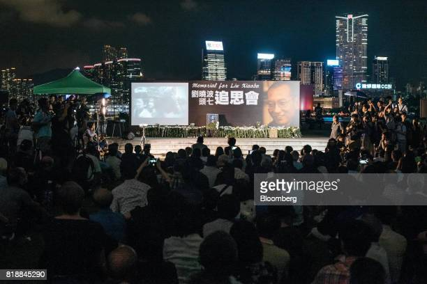 Vigil participants take part in a memorial vigil held for Chinese Nobel Peace Prizewinner Liu Xiaobo in Hong Kong China on Wednesday July 19 2017 Liu...