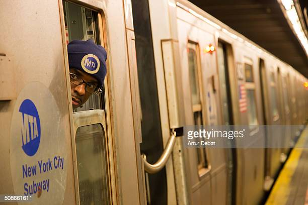 Vigilant with his head of the window in the subway train of Manhattan New York City