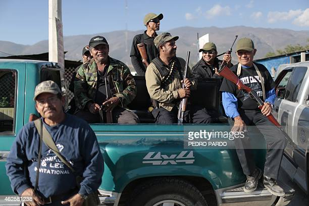 Vigilante group members at the community of Petaquillas attempt to install a checkpoint in Chilpancingo Guerrero State Mexico on January 31 2015...