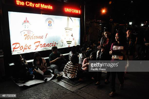 Vigils camp out early outside the gates of the University of Santo Tomas on Saturday night 3rd day of the visit of Pope Francis in the Philippines to...