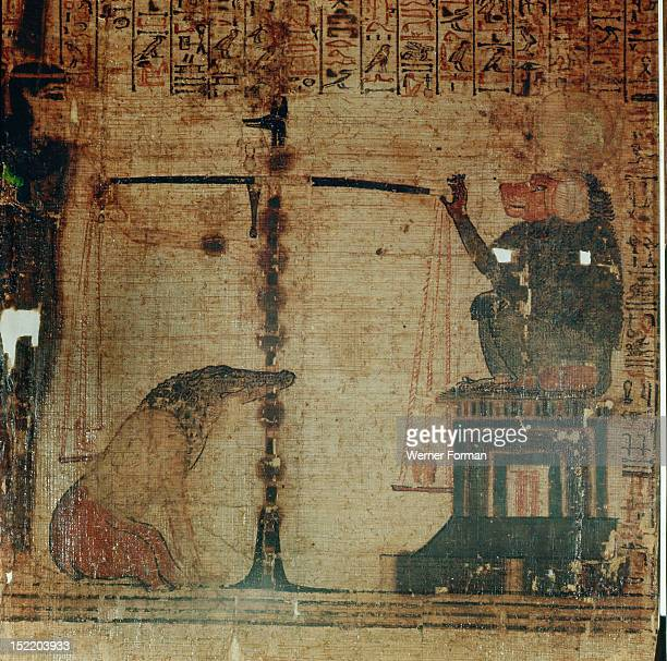 A vignette from the Book of the Dead of Kenna It shows the Day of Judgement in the hall of OsirisThoth weighs the dead mans heart The crocodile...