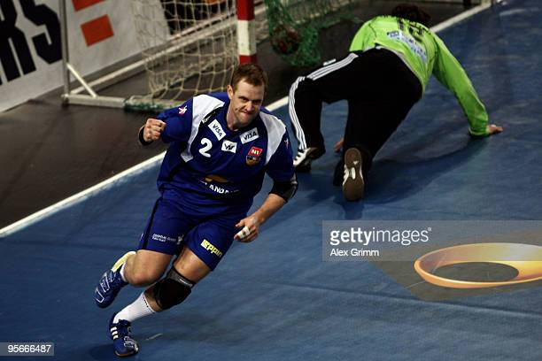 Vignir Svavarsson of Iceland celebrates a goal as goalkeeper Silvio Heinevetter of Germany reacts during the international handball friendly match...