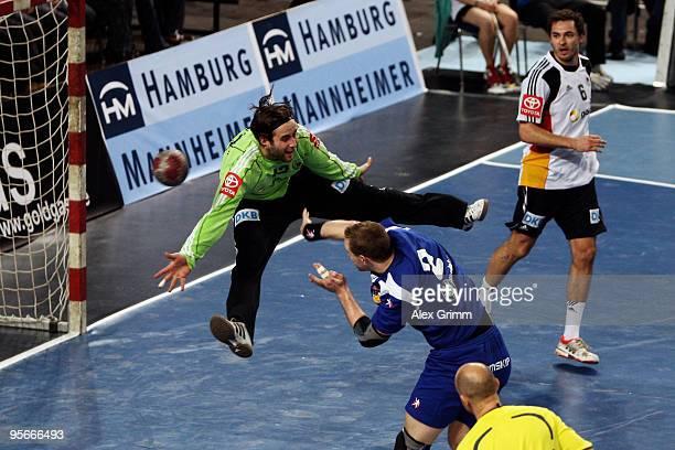 Vignir Svavarsson of Iceland scores a goal against goalkeeper Silvio Heinevetter of Germany during the international handball friendly match between...