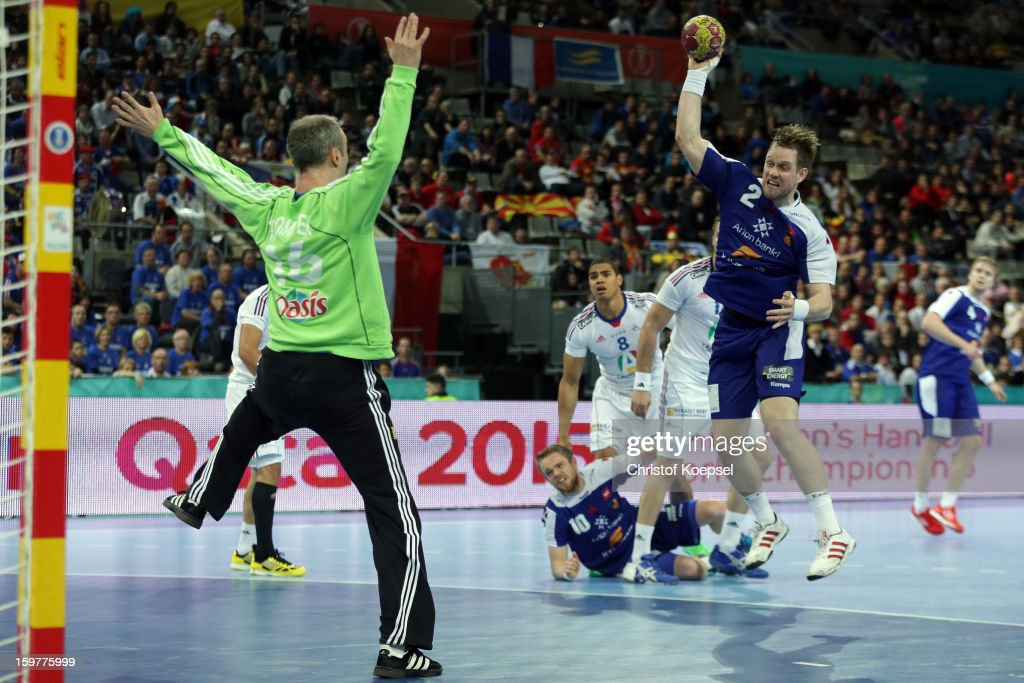 Vignir Svavarsson of Iceland (R) scores a goal Thierry Omeyer of France (L) during the round of sixteen match between Iceland and France at Palau Sant Jordi on January 20, 2013 in Barcelona, Spain.