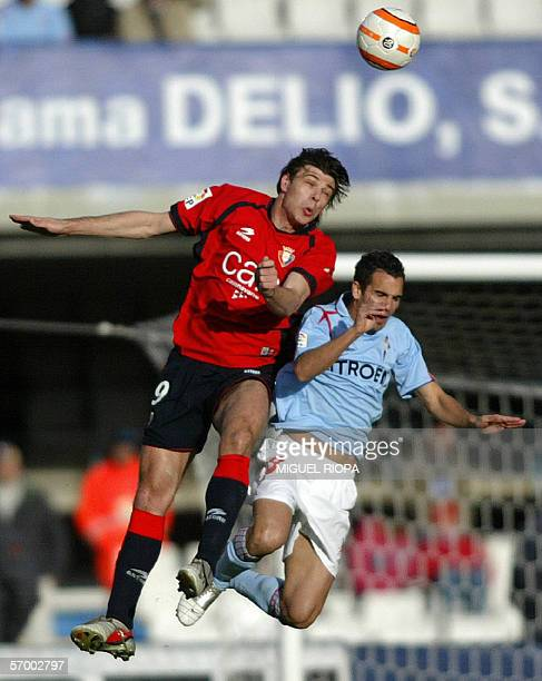 Celta Vigo's Angel Lopez jumps for the ball with Osasuna's Serbian Savo Milosevic during their Spanish first league football match at Balaidos...