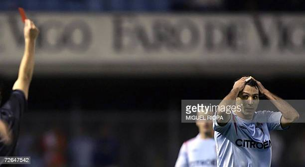 Celta Vigo's Argentinian midfielder Gustavo Lopez reacts after receiving a red card during the Spanish first League football match Celta Vigo vs Real...