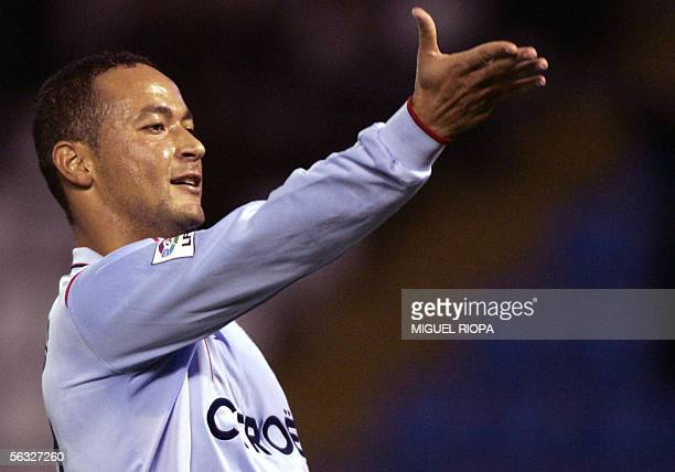 Celta Vigo's Brazilian Joao Nelo Baiano celebrates after scoring the 2nd goal against Betis during their Spanish first league football match at...