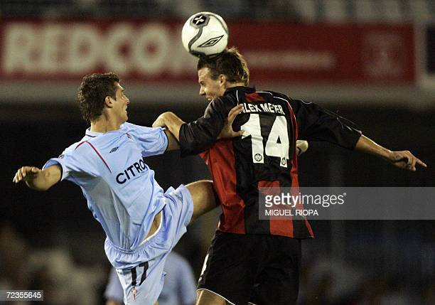 Celta Vigo's Romanian Gabriel Tamas heads the ball with Eintracht's Alexander Meier during a UEFA Cup group H football match at the Balaidos Stadium...