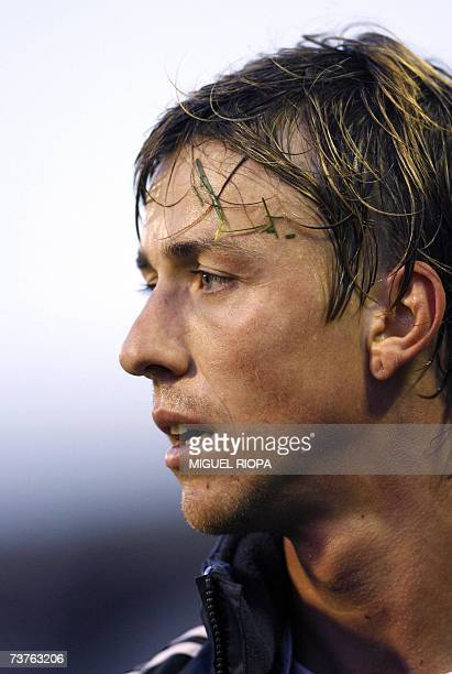 Real Madrid's midfielder Jose Maria Gutierrez 'Guti' reacts to receiving a red card during the Spanish First League football match against Celta Vigo...