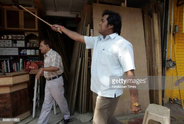 Viiolence MNS attacks Outsiders MNS workers forcibly close down shops near Sanjay Nirupam's office in Andheri on Tuesday The MNS activists had gone...