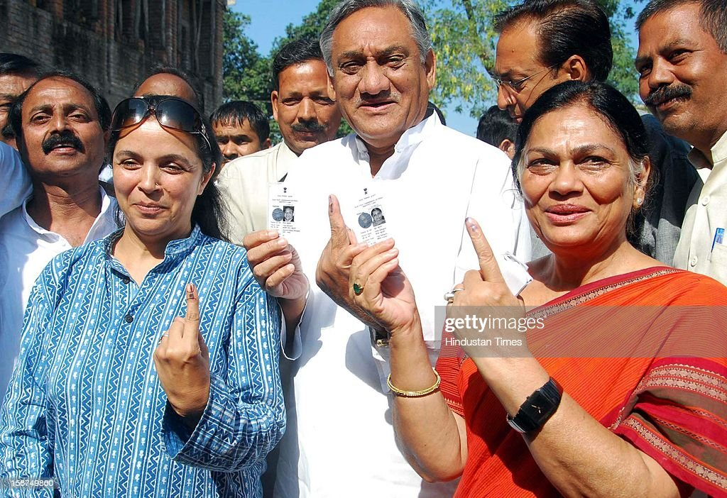 'DEHRADUN, INDIA - OCTOBER 10: CM Vijay Bahuguna (C) with his wife Sudha Bahuguna (R) coming out of from polling booth after casting his vote in Tehri by poll, on October 10, 2012 in Dehradun, India. ( Photo By Vinay S Kumar/Hindustan Times via Getty Images)'