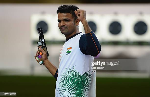 Vijay Kumar of India celebrates winning the silver medal in the Men's 50m Rifle Prone Shooting final on Day 7 of the London 2012 Olympic Games at The...
