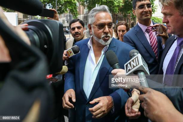 Vijay Mallya founder and chairman of Kingfisher Airlines Ltd center speaks to members of the media as he arrives at Westminster Magistrates' Court in...