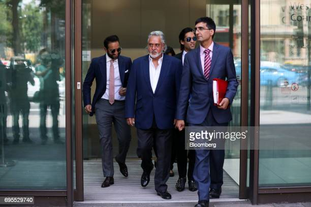 Vijay Mallya founder and chairman of Kingfisher Airlines Ltd center leaves Westminster Magistrates' Court in London UK on Tuesday June 13 2017 Mallya...