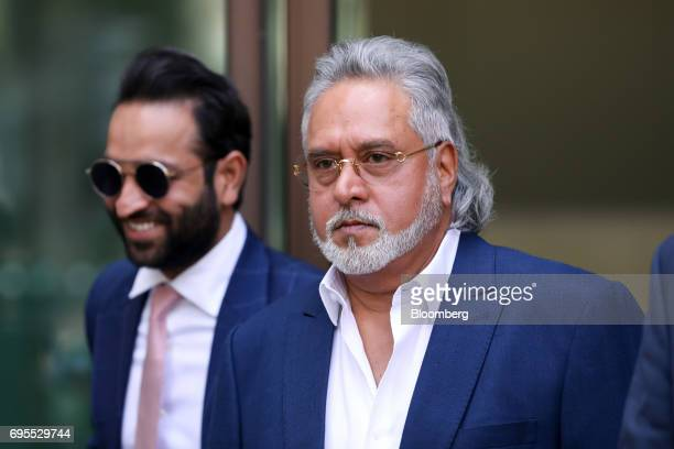 Vijay Mallya founder and chairman of Kingfisher Airlines Ltd right leaves Westminster Magistrates' Court in London UK on Tuesday June 13 2017 Mallya...