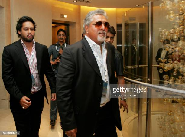 Vijay Mallya owner of Royal Challengers Bangalore his son Siddharth Mallya as they arrive to attend the Indian Premier League auction in Mumbai on...