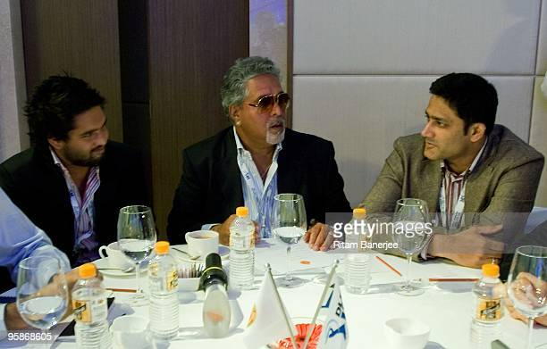 Vijay Mallya owner of the Royal Challengers Bangalore talks with Anil Kumble Captain of Royal Challengers Bangalore as his son Siddharth Mallya looks...