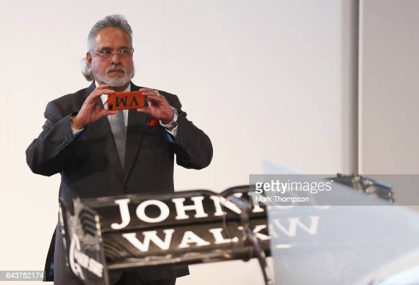 Vijay Mallya Team Principal and Managing Director takes a photo of the VJM10 car during the Sahara Force India Formula One team launch at Silverstone...