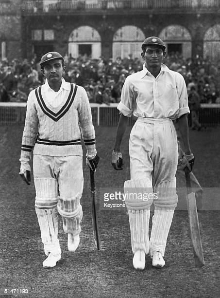 Vijay Merchant and Mushtaq Ali of All India walk out during the first day of play against England in the Test Match at Old Trafford 25th July 1936