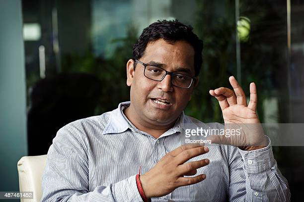 Vijay Shekhar Sharma founder and chairman of One97 Communications Ltd gestures as he speaks during an interview at the company's headquarters in...
