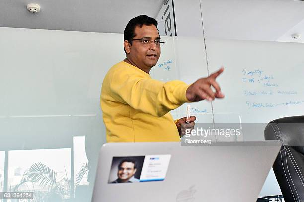 Vijay Shekhar Sharma founder and chairman of One97 Communications Ltd operator of PayTM gestures as he speaks to colleagues during a meeting at the...