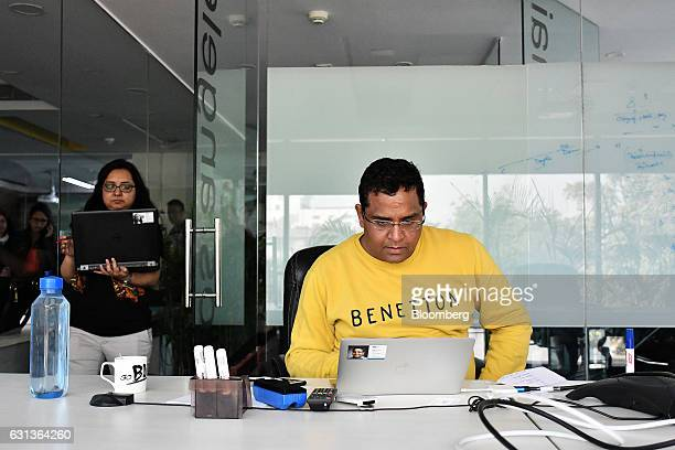 Vijay Shekhar Sharma founder and chairman of One97 Communications Ltd operator of PayTM right works on a laptop computer at the company's office in...
