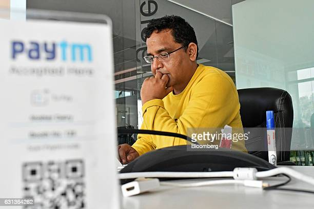 Vijay Shekhar Sharma founder and chairman of One97 Communications Ltd operator of PayTM uses a laptop computer at the company's office in Noida Uttar...