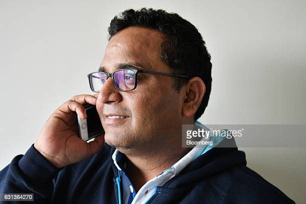 Vijay Shekhar Sharma founder and chairman of One97 Communications Ltd operator of PayTM talks on a smartphone at the company's office in Noida Uttar...