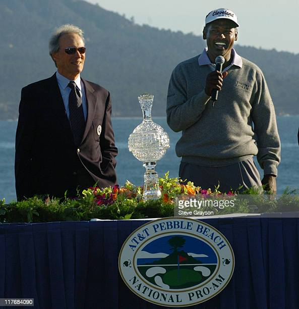 Vijay Singh accepts the winners trophy from Clint Eastwood presents the at the final round of the PGA Tour's 2004 ATT Pebble Beach National ProAm at...