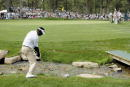 Vijay Singh chips the ball across the bank of a creek onto the 14th green during The International on August 9 2003 at Castle Pines Golf Club in...