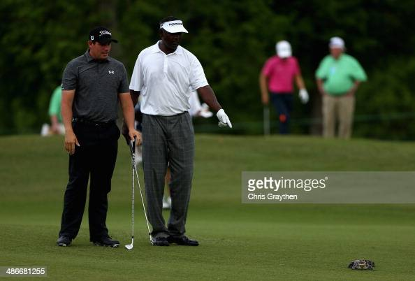 Vijay Singh has a run in with a baby alligator while trying to take his shot on the 7th during Round Two of the Zurich Classic of New Orleans at TPC...