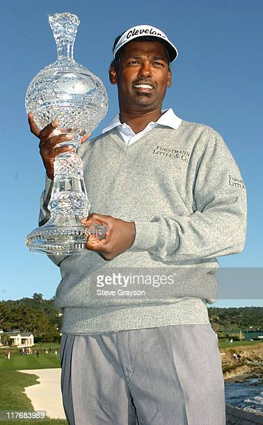 Vijay Singh holds the winner's trophy at the final round of the PGA Tour's 2004 ATT Pebble Beach National ProAm at Pebble Beach Golf Links February 8...