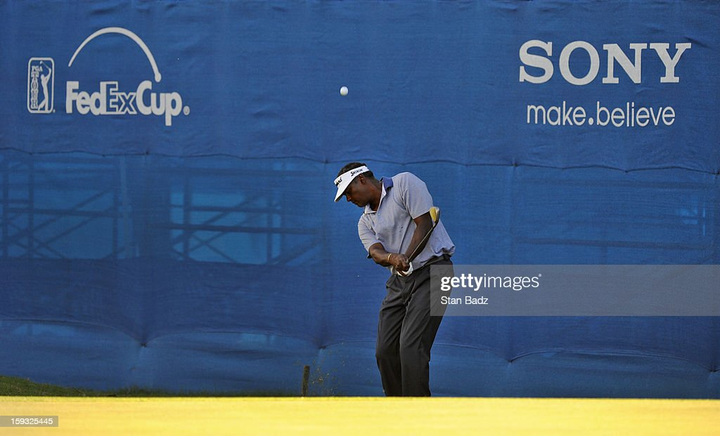 Vijay Singh of Fiji chips onto the 18th green during the second round of the Sony Open in Hawaii at Waialae Country Club on January 11, 2013 in Honolulu, Hawaii.