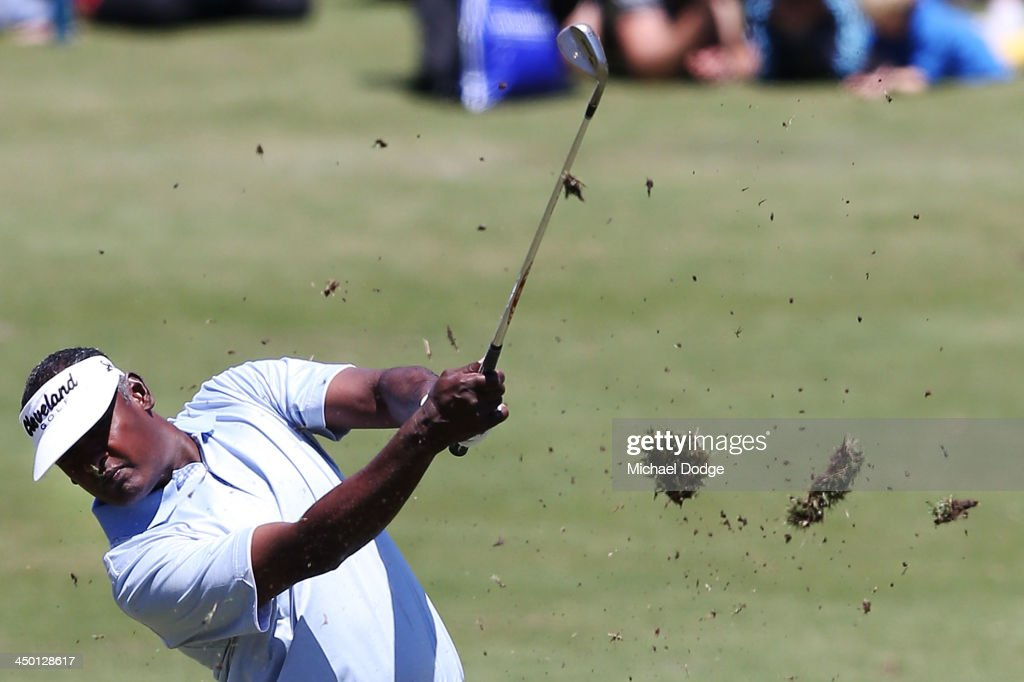 <a gi-track='captionPersonalityLinkClicked' href=/galleries/search?phrase=Vijay+Singh&family=editorial&specificpeople=179484 ng-click='$event.stopPropagation()'>Vijay Singh</a> of Fiji hits an approach shot off the first tee during round four of the 2013 Australian Masters at Royal Melbourne Golf Course on November 17, 2013 in Melbourne, Australia.