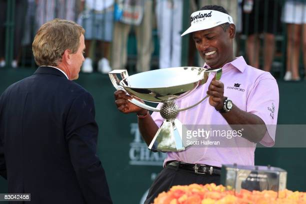 Vijay Singh of Fiji is presented with the FedExCup by PGA Tour Commissioner Tim Finchem after the final round of THE TOUR Championship presented by...