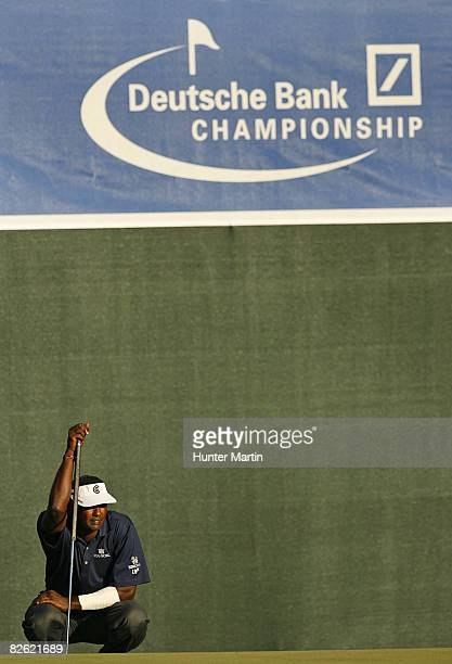 Vijay Singh of Fiji Islands lines up his eagle putt on the 18th hole during the final round of the Deutsche Bank Championship at TPC Boston on...