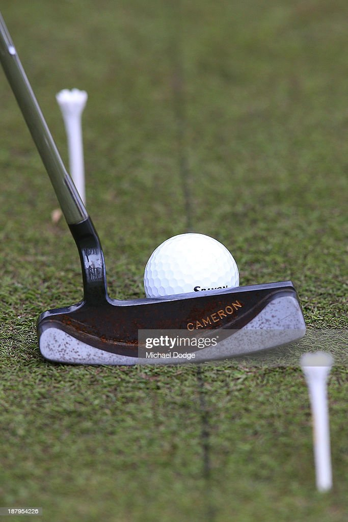 Vijay Singh of Fiji lines up a putter behind the ball on the practice green during round one of the 2013 Australian Masters at Royal Melbourne Golf Course on November 14, 2013 in Melbourne, Australia.