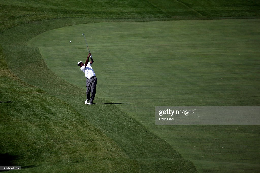 <a gi-track='captionPersonalityLinkClicked' href=/galleries/search?phrase=Vijay+Singh&family=editorial&specificpeople=179484 ng-click='$event.stopPropagation()'>Vijay Singh</a> of Fiji plays a shot on the 14th hole during the final round of the Quicken Loans National at Congressional Country Club on June 26, 2016 in Bethesda, Maryland.