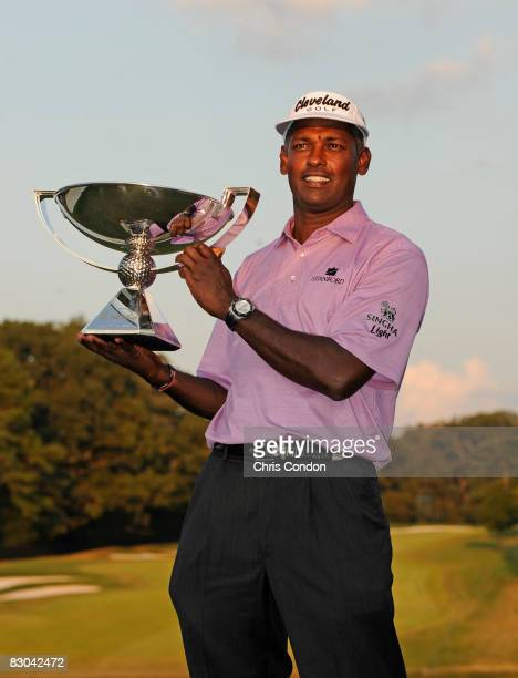 Vijay Singh of Fiji poses with the FedExCup trophy after the final round of THE TOUR Championship presented by CocaCola at East Lake Golf Club on...