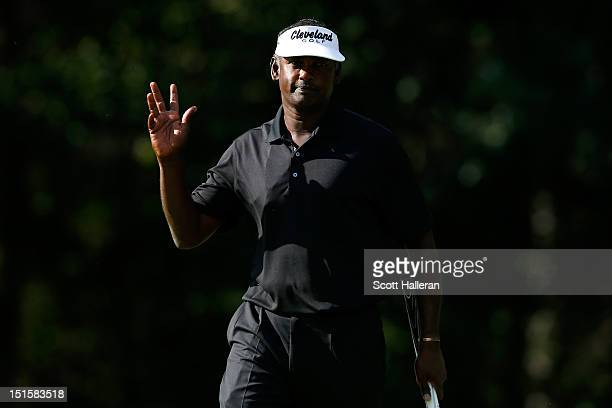 Vijay Singh of Fiji reacts after he made a birdie putt on the 11th hole green during the third round of the BMW Championship at Crooked Stick Golf...