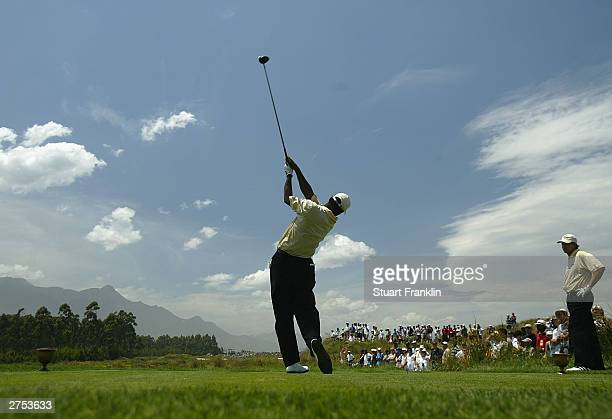 Vijay Singh of Fiji tees off on the 3rd hole during his match against Tiger Woods and Charles Howell III of USA during the second round of fourballs...