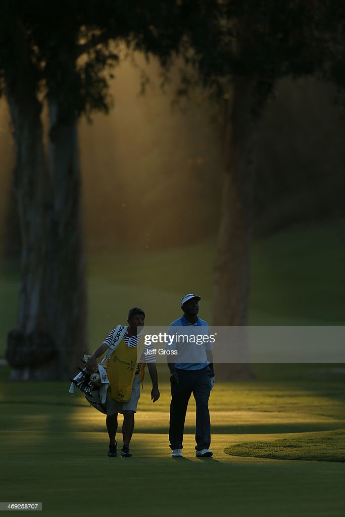 Vijay Singh of Fiji walks along the course with his caddie in the first round of the Northern Trust Open at the Riviera Country Club on February 13, 2014 in Pacific Palisades, California.