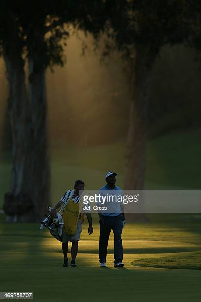 Vijay Singh of Fiji walks along the course with his caddie in the first round of the Northern Trust Open at the Riviera Country Club on February 13...