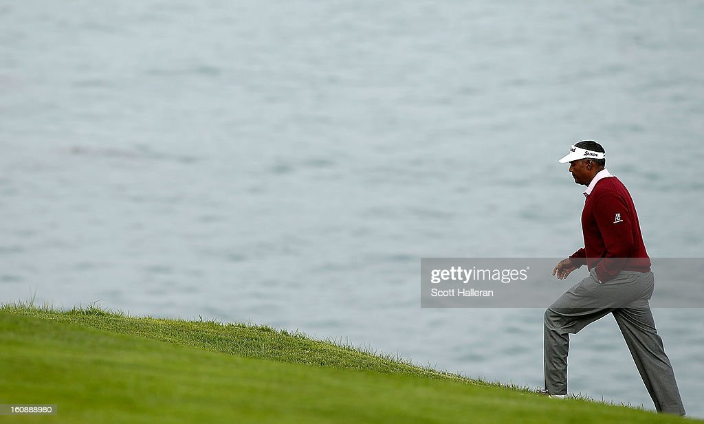 Vijay Singh of Fiji walks to the sixth green during the first round of the AT&T Pebble Beach National Pro-Am at Pebble Beach Golf Links on February 7, 2013 in Pebble Beach, California.