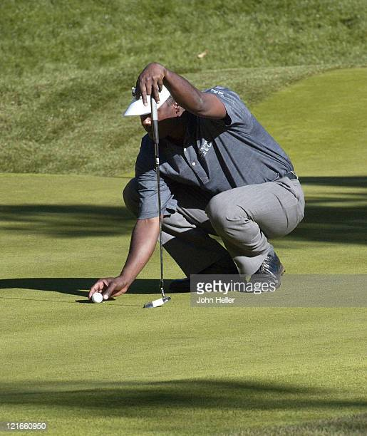 Vijay Singh sets his ball at the sixteenth green during thr third round of play at the Target World Challenge at Sherwood Country Club on December 11...